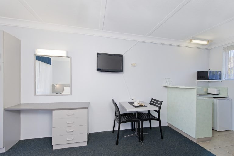 kitchenette, dining and vanity is some of whats inside in haven waters motel